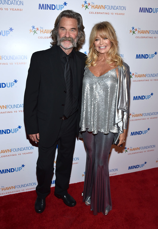 . Kurt Russell, left, and Goldie Hawn arrive to the inaugural �Goldie�s Love In for Kids�, a 70s-themed party to raise awareness and funds for MindUP, on Friday, Nov. 21, 2014 in Los Angeles. (Photo by John Shearer/Invision/AP)
