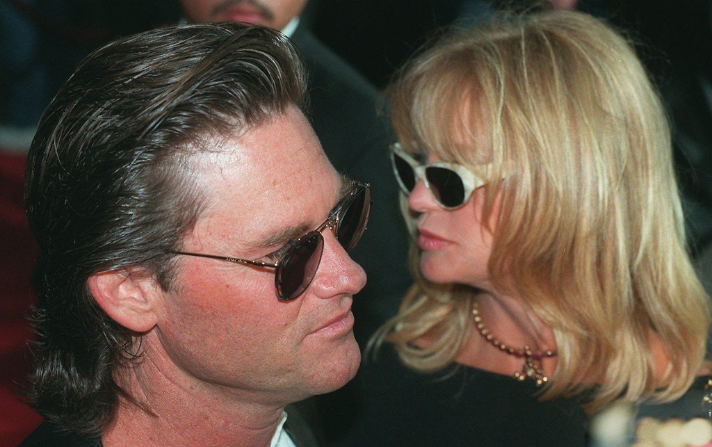 """. Kurt Russell, star of the new film \""""John Carpenter\'s Escape from L.A.,\"""" and his companion Goldie Hawn arrive at the premiere of the film at the Mann Chinese Theater in the Hollywood section of Los Angeles, Wednesday, Aug. 7, 1996. Russell returns to his role as one-eyed renegade, Snake Plissken in a sequel to the 1981 cult favorite \""""Escape from New York.\"""" (AP Photo/Chris Pizzello)"""