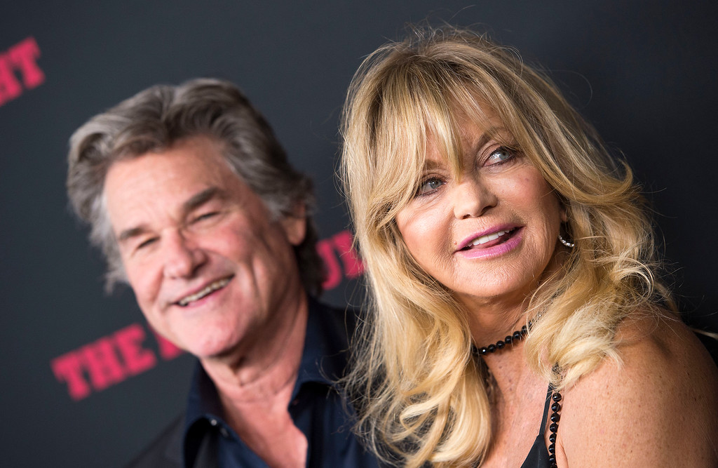. Actors Kurt Russell (L) and Goldie Hawn attend the Hateful Eight Premiere in Hollywood, California, on December 7, 2015.    (VALERIE MACON/AFP/Getty Images)