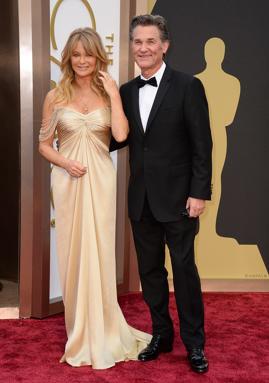 . Goldie Hawn, left, and Kurt Russell arrive at the Oscars on Sunday, March 2, 2014, at the Dolby Theatre in Los Angeles.  (Photo by Jordan Strauss/Invision/AP)