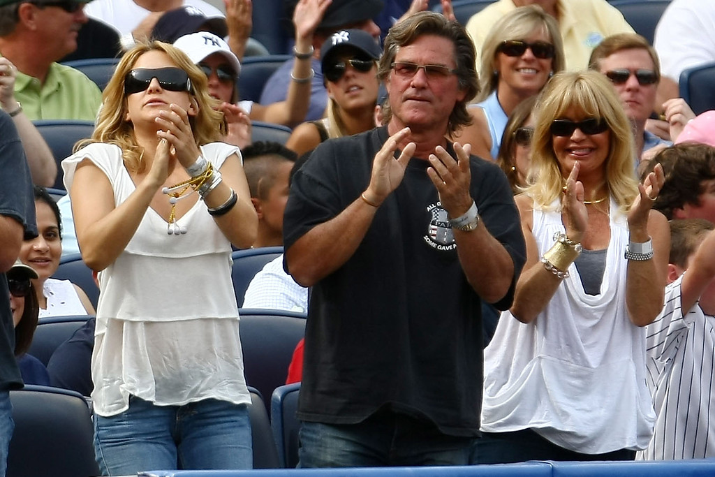 . NEW YORK - AUGUST 08: (L-R) Kate Hudson, Kurt Russell and Goldie Hawn clap as Alex Rodriguez of the New York Yankees steps up to bat against the Boston Red Sox during their game on August 8, 2009 at Yankee Stadium in the Bronx borough of New York City.  (Photo by Chris McGrath/Getty Images)