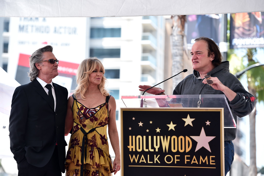 . HOLLYWOOD, CA - MAY 04:  Filmmaker Quentin Tarantino (R) speaks onstage as actors Kurt Russell and Goldie Hawn are honored with a double star ceremony on the Hollywood Walk of Fame on May 4, 2017 in Hollywood, California.  (Photo by Alberto E. Rodriguez/Getty Images)