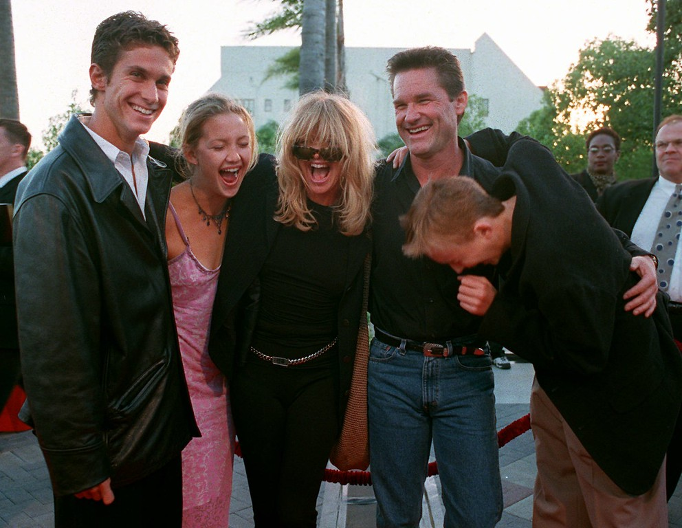 """. Actress Goldie Hawn, third from left, and actor Kurt Russell laugh with, from left to right, Hawn\'s children Oliver Hudson, Kate Hudson, and Boston Russell, before attending the premeire of Russell\'s new motion picture \""""Breakdown,\"""" in Los Angeles, Calif., April 24, 1997.  (AP Photo/E.J. Flynn)"""