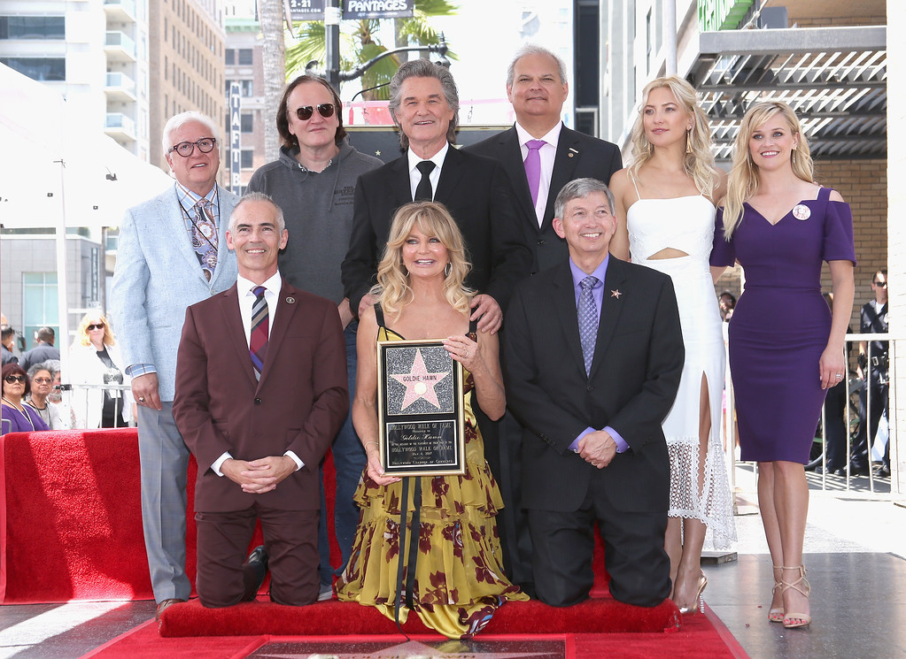 . HOLLYWOOD, CA - MAY 04: (2nd L-R top) Director Quentin Tarantino, Honoree Kurt Russell, guest, actors Kate Hudson and Reese Witherspoon (L-R bottom) Los Angeles Councilmember Mitch O\'Farrell, Honoree Goldie Hawn and Hollywood Chamber of Commerce, President/CEO Leron Gubler at Goldie Hawn and Kurt Russell are honored with a Star On the Hollywood Walk of Fame on May 4, 2017 in Hollywood, California.  (Photo by Jesse Grant/Getty Images for Disney)