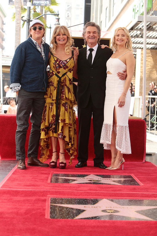 . Boston Russell, Goldie Hawn, Kurt Russell and Kate Hudson seen at Goldie Hawn and Kurt Russell honored with a double star ceremony on the Hollywood Walk of Fame on Thursday, May 4, 2017, in Los Angeles. (Photo by Eric Charbonneau/Invision for Twentieth Century Fox/AP Images)