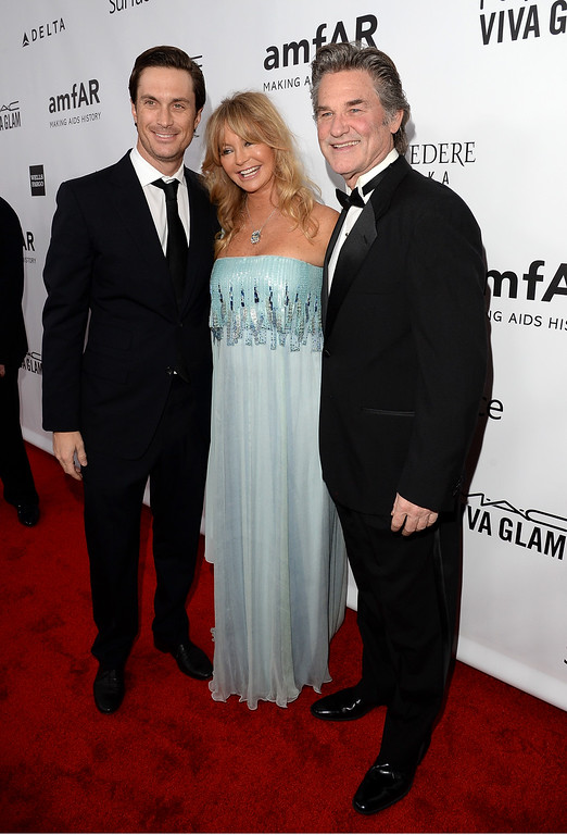 . LOS ANGELES, CA - DECEMBER 12:  (L-R) Actors Oliver Hudson, Goldie Hawn and Kurt Russell attend the 2013 amfAR Inspiration Gala Los Angeles presented by MAC Viva Glam at Milk Studios on December 12, 2013 in Los Angeles, California.  (Photo by Jason Merritt/Getty Images for amfAR)