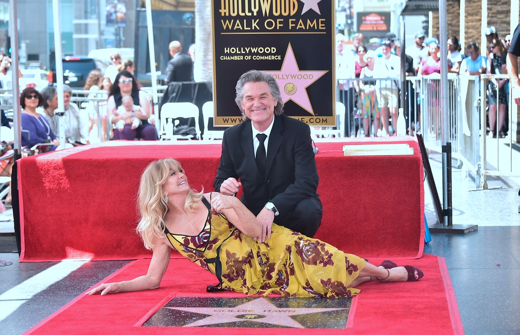 . Goldie Hawn and Kurt Russell pose at their Walk of Fame Stars ceremony in Hollywood, California on May 4, 2017.  (FREDERIC J. BROWN/AFP/Getty Images)
