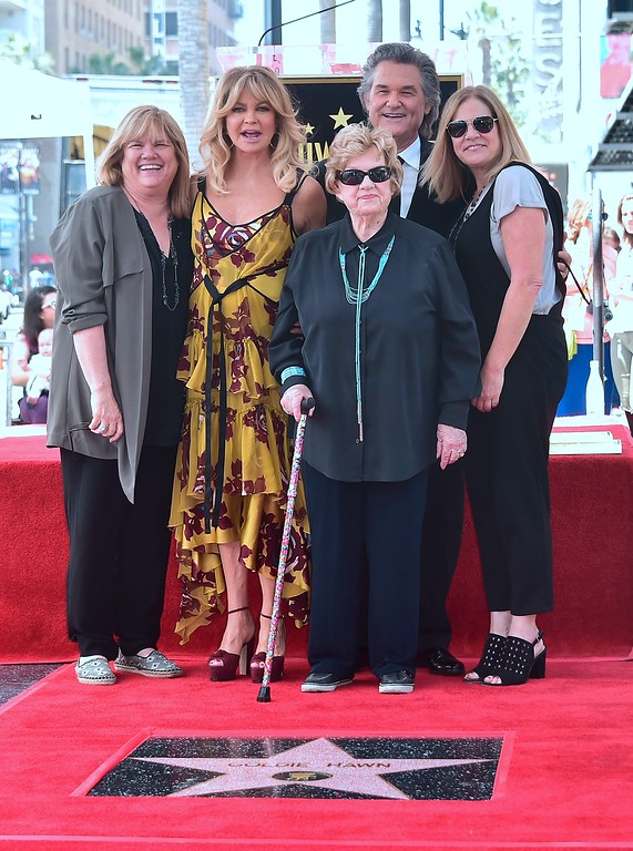 . Kurt Russell and Goldie Hawn (2nd L) pose with Kurt\'s mother (C-bottom) and sisters at their Walk of Fame Stars ceremony in Hollywood, California on May 4, 2017.  (FREDERIC J. BROWN/AFP/Getty Images)