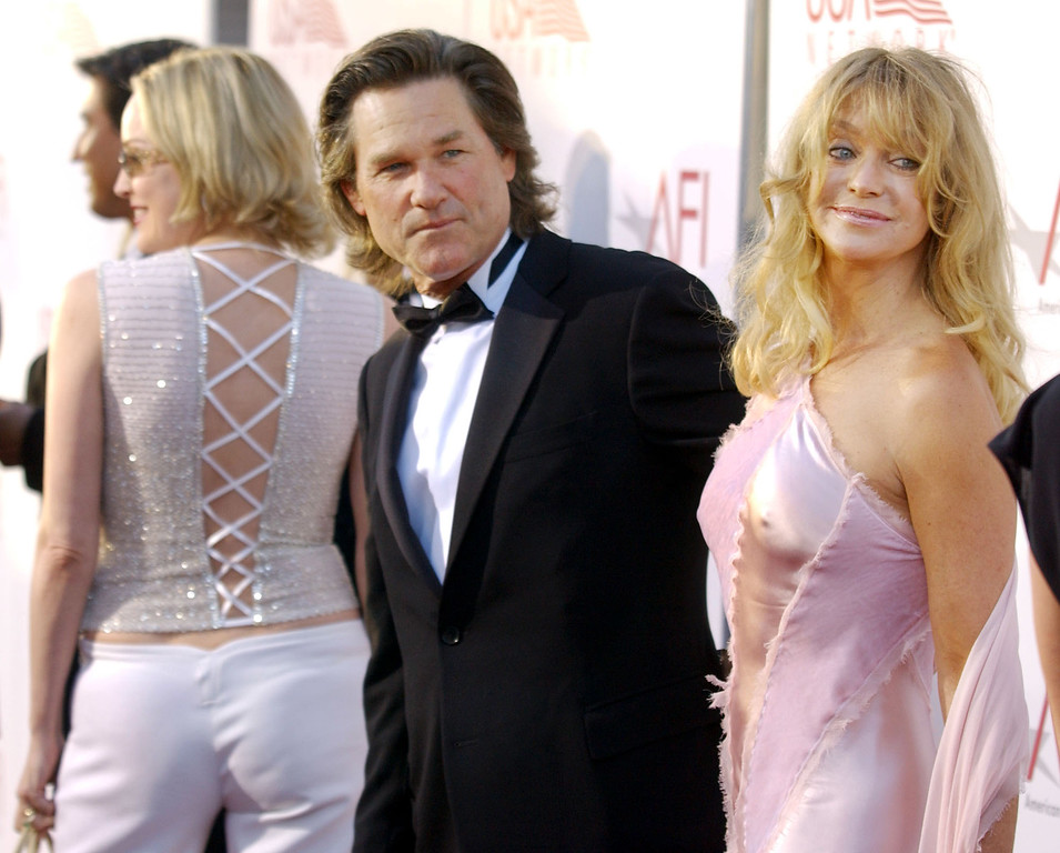 . Actors Kurt Russell and Goldie Hawn, right, arrive at the 30th AFI Life Achievement Award at the Kodak Theater in Los Angeles, Wednesday, June 12, 2002. At far left is actress Sharon Stone. (AP Photo/Chris Pizzello)