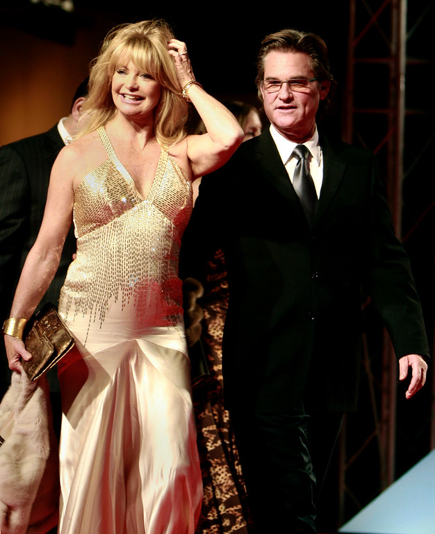 . U.S. actors Kurt Russell, right, and Goldie Hawn, left, arrive for the opening of the 32nd Cairo international film festival, in Cairo, Egypt, Tuesday, Nov. 18, 2008. (AP Photo/Amr Nabil)