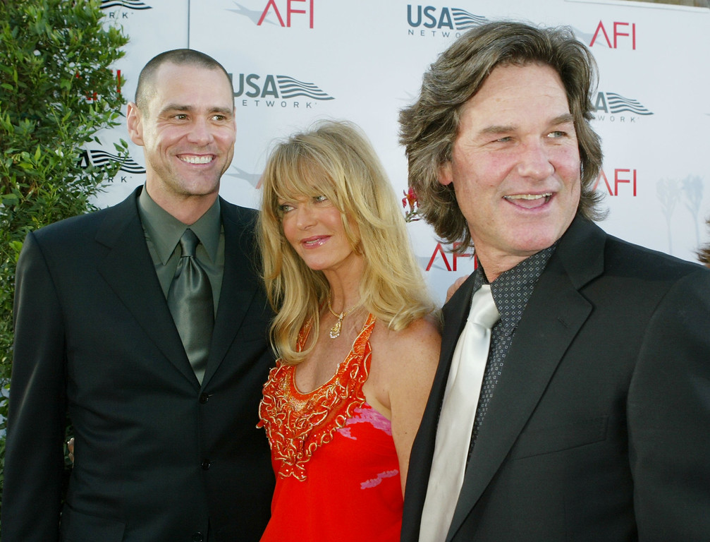 """. HOLLYWOOD - JUNE 10:  (L-R)  Actors Jim Carrey, Goldie Hawn and Kurt Russell attend the \""""32nd Annual AFI Lifetime Achievement Award: A Tribute to Meryl Streep\"""" held at the Kodak Theatre, June 10, 2004 in Hollywood, California. (Photo by Kevin Winter/Getty Images)"""