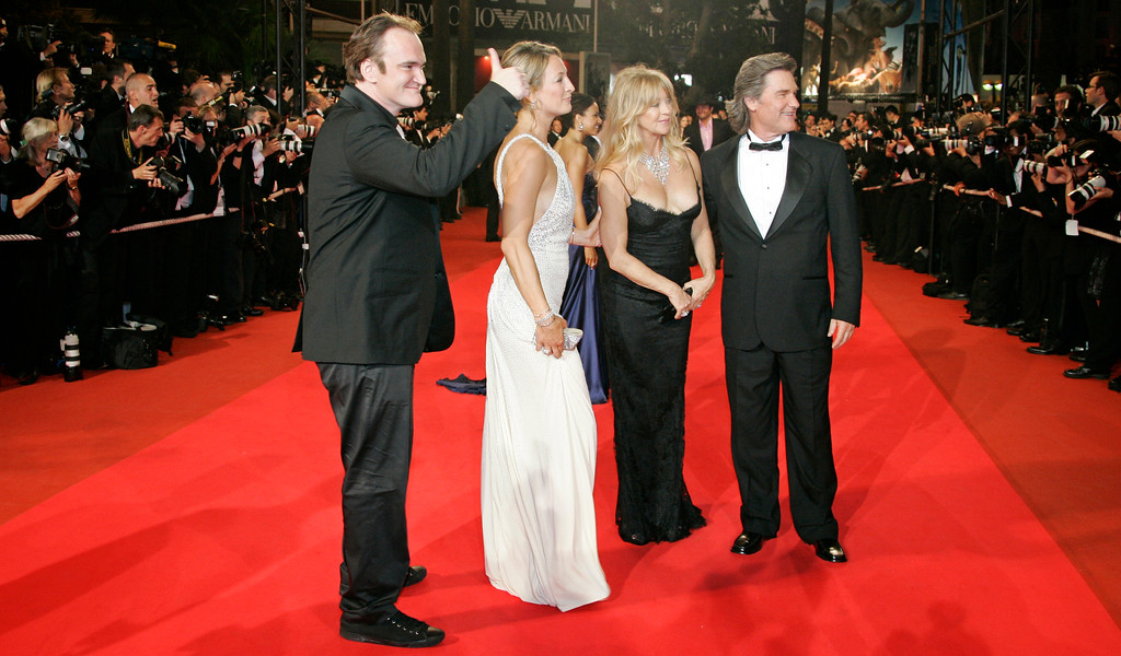 """. From left, American director Quentin Tarantino, New Zealand actress Zoe Bell, American actress Goldie Hawn and American actor Kurt Russell arrive for the screening of the film \""""Death Proof,\"""" at the 60th International film festival in Cannes, southern France, on Tuesday, May 22, 2007. (AP Photo/Francois Mori)"""