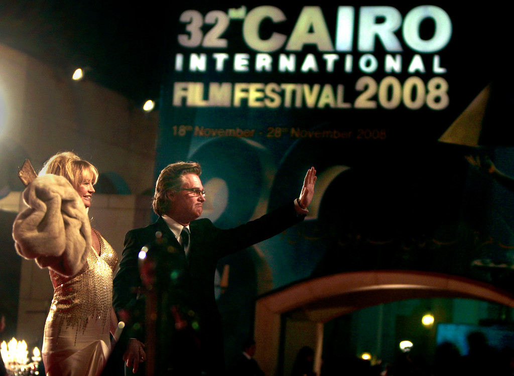 . U.S. actors Kurt Russell, right, and Goldie Hawn, left, wave to photographers as they arrive for the opening of the 32nd Cairo international film festival, in Cairo, Egypt, Tuesday, Nov. 18, 2008. (AP Photo/Amr Nabil)
