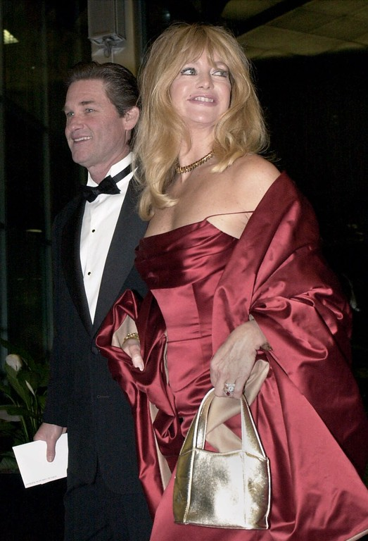 . Actors Kurt Russell and Goldie Hawn enter the State Department building for the Kennedy Center Honors dinner in Washington, Saturday, Dec. 12, 2000. (AP Photo/Stephen J. Boitano)