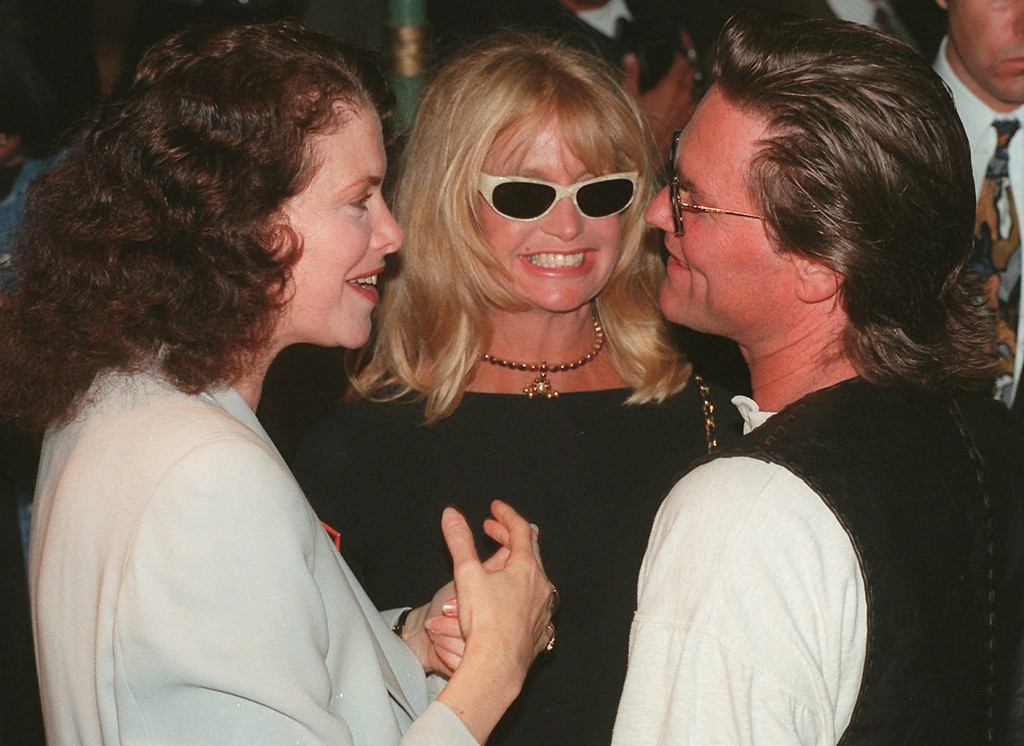 """. File - Sherry Lansing, left, chairman of Paramount Pictures\' Motion Picture Group, and Kurt Russell, star of the new Paramount film \""""John Carpenter\'s Escape from L.A.,\"""" chat as Russell\'s companion Goldie Hawn looks on at the world premiere of the film, Wednesday, Aug. 7, 1996, at the Mann\'s Chinese Theater in the Hollywood section of Los Angeles. Russell returns to his role as one-eyed renegade Snake Plissken in the sequel to the 1981 cult favorite, \""""Escape from New York.\"""" (AP Photo/Chris Pizzello)"""