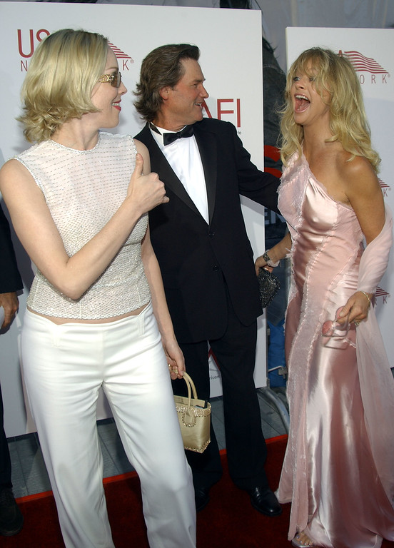 . LOS ANGELES - JUNE 12:  Actress Sharon Stone (L) greets actors Kurt Russell and Goldie Hawn at the 30th AFI Life Achievement Award June 12, 2002 in Hollywood, California. The event, which honored actor Tom Hanks, was held by the American Film Institute. (Photo by Vince Bucci/Getty Images)