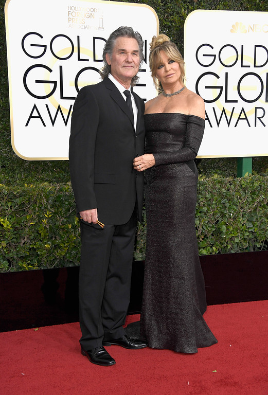 . BEVERLY HILLS, CA - JANUARY 08:  Actors Kurt Russell (L) and Goldie Hawn attend the 74th Annual Golden Globe Awards at The Beverly Hilton Hotel on January 8, 2017 in Beverly Hills, California.  (Photo by Frazer Harrison/Getty Images)