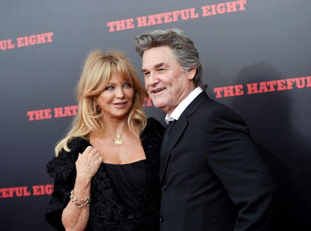 """. FILE - In this Dec. 14, 2015, file photo, actors Goldie Hawn and Kurt Russell attend the premiere of \""""The Hateful Eight\"""" at the Ziegfeld Theatre in New York. Hawn tells British chat show \""""Loose Women\"""" that she \""""would have been long divorced\"""" is she had gotten married. (Photo by Evan Agostini/Invision/AP, File)"""