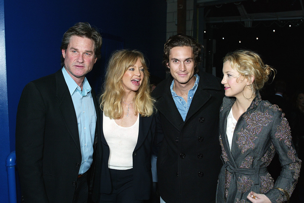 """. Actors (L-R) Kurt Russell, Goldie Hawn, Oliver Hudson and his sister Kate Hudson pose at the post-premiere party for \""""Dark Blue\"""" on Febraury 12, 2003 in Los Angeles, California. (Photo by Kevin Winter/Getty Images)"""