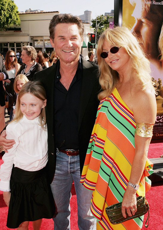 """. LOS ANGELES - OCTOBER 9:  Actors Dakota Fanning (L), Kurt Russell and Goldie Hawn pose at the premiere of DreamWork\'s \""""Dreamer\"""" at the Village Theater on October 9, 2005 in Los Angeles, California. (Photo by Kevin Winter/Getty Images)"""