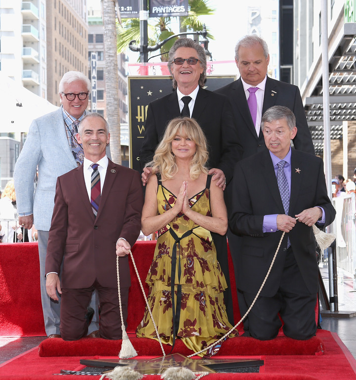 . HOLLYWOOD, CA - MAY 04: Honoree Kurt Russell ( C top), (L-R bottom) Los Angeles Councilmember Mitch O\'Farrell, Honoree Goldie Hawn and Hollywood Chamber of Commerce, President/CEO Leron Gubler at Goldie Hawn and Kurt Russell are honored with a Star On the Hollywood Walk of Fame on May 4, 2017 in Hollywood, California.  (Photo by Jesse Grant/Getty Images for Disney)