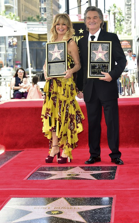 . Goldie Hawn and Kurt Russel pose with their stars on the Walk of Fame in Hollywood, California on May 4, 2017.  (FREDERIC J. BROWN/AFP/Getty Images)