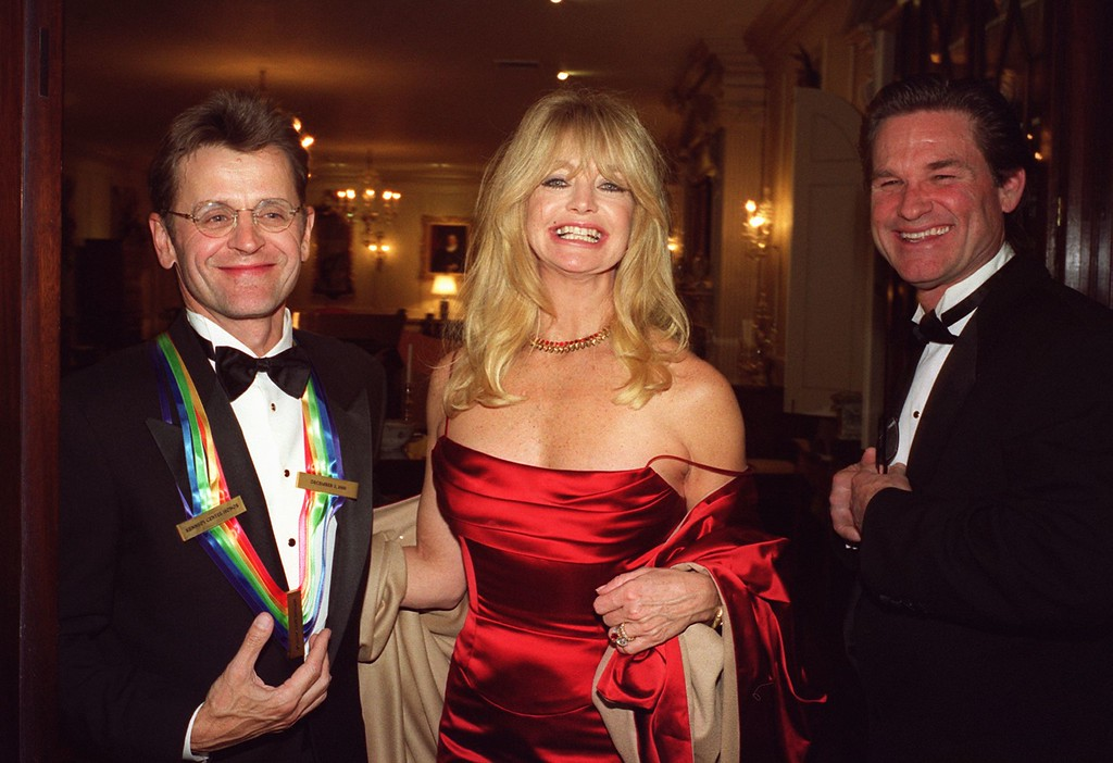 . WASHINGTON, DC - DECEMBER 2:  US actress Goldie Hawn, accompanied by her partner Kurt Russell (R), poses with Kennedy Center Honoree, dancer Mikhail Baryshnikov (L) at the Kennedy Center Honors Gala in Washington DC 02 December, 2000.  (NESHAN H. NALTCHAYAN/AFP/Getty Images)