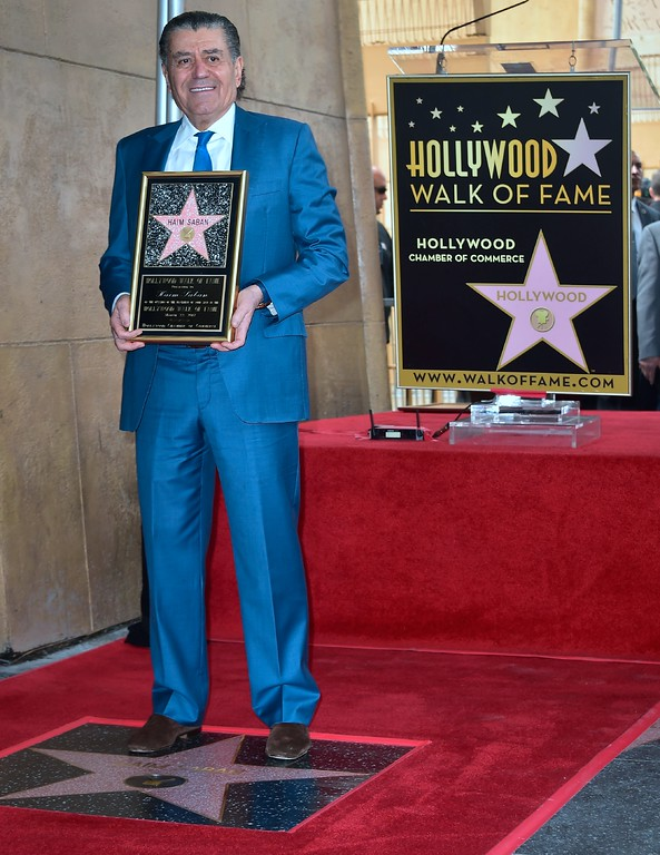 . Producer and Power Rangers creator Haim Saban poses at his Hollywood Walk of Fame Star ceremony on March 22, 2017 in Hollywood, California, where he received the 2,605th Star in the category of Television.  (FREDERIC J. BROWN/AFP/Getty Images)