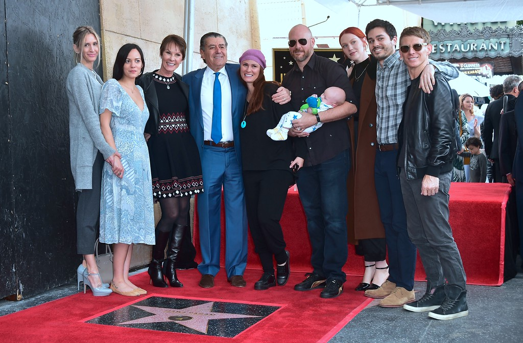 . Producer and Power Rangers creator Haim Saban poses with his family at his Hollywood Walk of Fame Star ceremony on March 22, 2017 in Hollywood, California, where he received the 2,605th Star in the category of Television.  (FREDERIC J. BROWN/AFP/Getty Images)