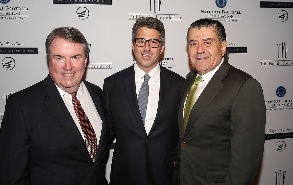. WESTWOOD, CA - NOVEMBER 18: (L-R) National Football Foundation President and CEO, Steven J. Hatchell, Wasserman Media Group CEO, Casey Wasserman and Saban Entertainment Group Founder, Haim Saban attend the National Football Foundation Leadership Hall of Fame Luncheon Honoring Casey Wasserman at UCLA\'s Pauley Pavilion on November 18, 2015 in Westwood, California.  (Photo by Jesse Grant/Getty Images for National Football Foundation)