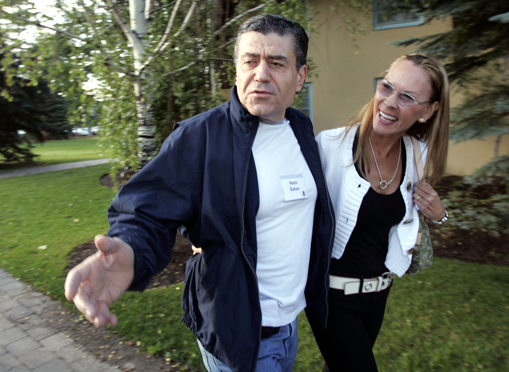 . Haim Saban, left, chairman and CEO of Saban Capital Group, Inc., arrives with Cheryl Saban, Wednesday, July 12, 2006, for the annual Allen & Co. media conference in Sun Valley, Idaho. The conference kicked off last night. (AP Photo/Elaine Thompson)