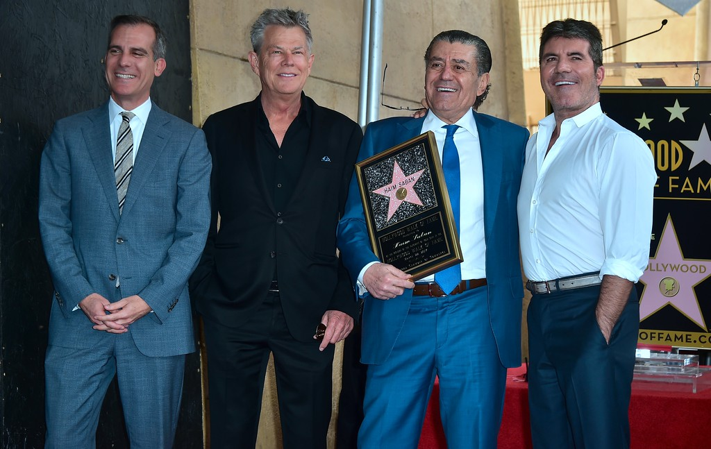 . Producer and Power Rangers creator Haim Saban (L) poses with Producer Simon Cowell at his Hollywood Walk of Fame Star ceremony on March 22, 2017 in Hollywood, California, where he received the 2,605th Star in the category of Television.  (FREDERIC J. BROWN/AFP/Getty Images)