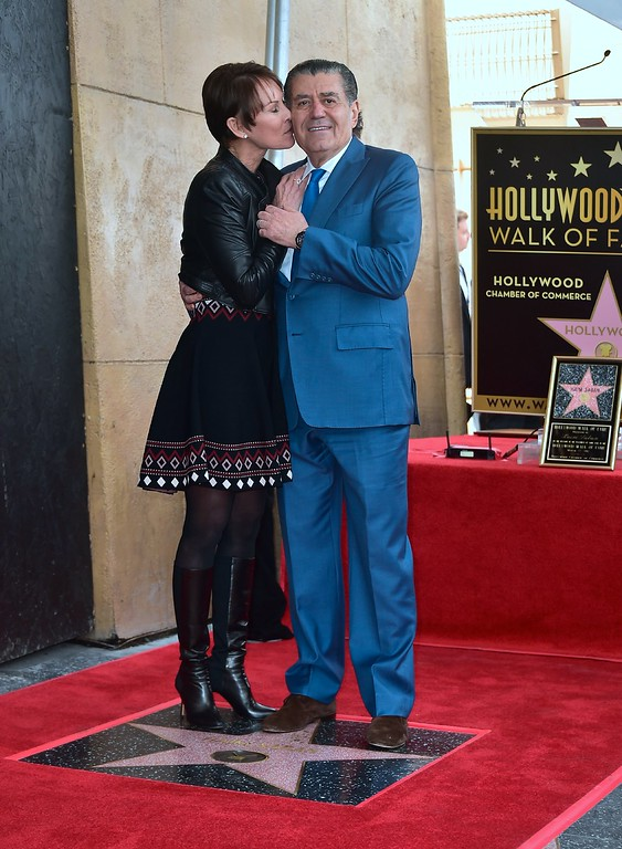 . Producer and Power Rangers creator Haim Saban receives a kiss from his wife Cheryl at his Hollywood Walk of Fame Star ceremony on March 22, 2017 in Hollywood, California, where he received the 2,605th Star in the category of Television.  (FREDERIC J. BROWN/AFP/Getty Images)