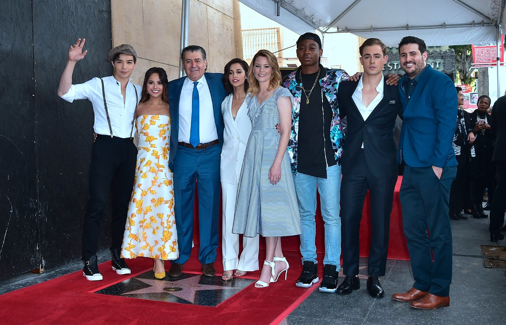 . Producer and Power Rangers creator Haim Saban poses with the cast from the Power Rangers movie at his Hollywood Walk of Fame Star ceremony on March 22, 2017 in Hollywood, California, where he received the 2,605th Star in the category of Television.  (FREDERIC J. BROWN/AFP/Getty Images)