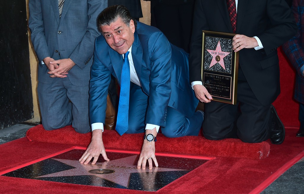 . Producer and Power Rangers creator Haim Saban touches his Hollywood Walk of Fame Star at a ceremony on March 22, 2017 in Hollywood, California, where he received the 2,605th Star in the category of Television.  (FREDERIC J. BROWN/AFP/Getty Images)