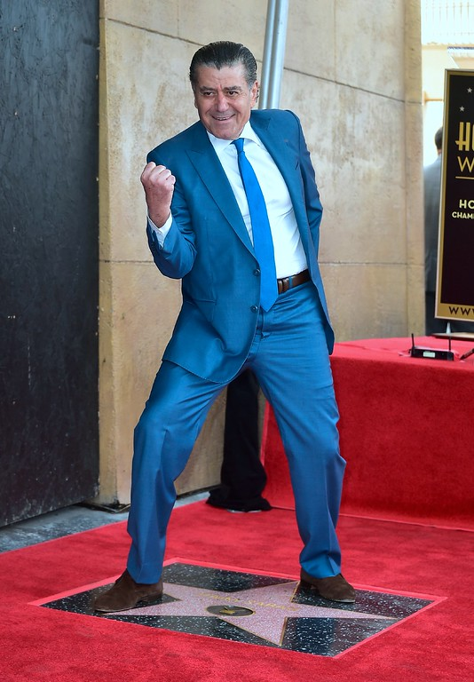 . Producer and Power Rangers creator Haim Saban poses on his Hollywood Walk of Fame Star ceremony on March 22, 2017 in Hollywood, California, where he received the 2,605th Star in the category of Television.  (FREDERIC J. BROWN/AFP/Getty Images)