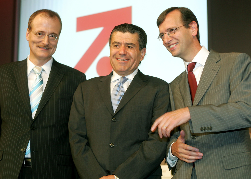 . Christian Nienhaus, chairman of the newspaper group Bild, left, Haim Saban, CEO of KSF Corp., center, and Guillaume de Posch, CEO of Germany\'s ProSiebenSat.1 media group, pose prior to the shareholders meeting in Munich, southern Germany, Wednesday, Aug. 2, 2006.  (AP Photo/Diether Endlicher)
