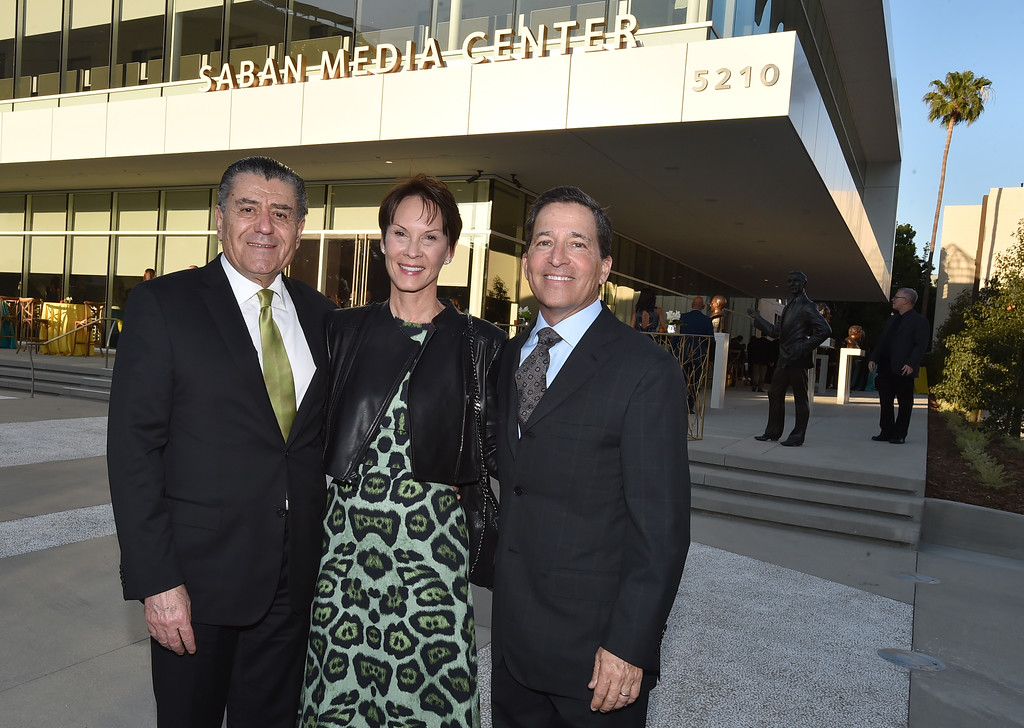 . Haim Saban, from left, Cheryl Saban and Bruce Rosenblum, Television Academy Chairman and CEO, attend the Television Academy�s 70th Anniversary Gala and Opening Celebration for its new Saban Media Center on June 2, 2016, in the NoHo Arts District in Los Angeles. (Photo by Jordan Strauss/Invision for the Television Academy/AP Images)