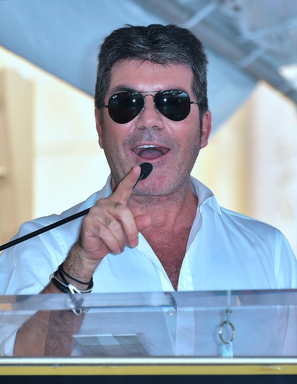 . Simon Cowell speaks at producer and Power Rangers creator Haim Saban\'s Hollywood Walk of Fame Star ceremony on March 22, 2017 in Hollywood, California, where he received the 2,605th Star in the category of Television.  (FREDERIC J. BROWN/AFP/Getty Images)
