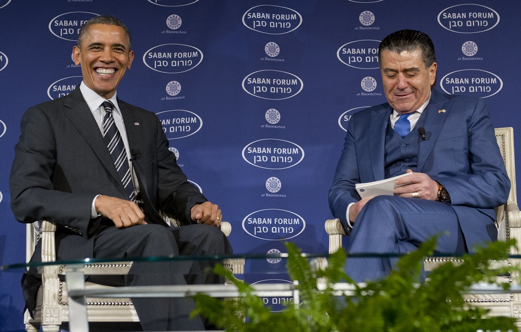. US President Barack Obama speaks alongside Saban Forum Chairman Haim Saban (R) about US, Iran and Israel and the Middle East at the 10th Anniversary Saban Forum hosted by the Saban Center for Middle East Policy at Brookings Institution in Washington, DC, December 7, 2013. (SAUL LOEB/AFP/Getty Images)