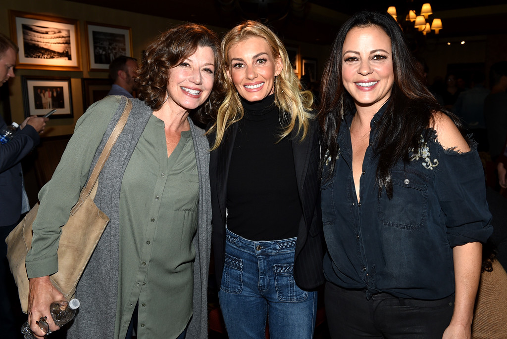 . NASHVILLE, TN - SEPTEMBER 12:  In this handout photo provided by Hand in Hand, Amy Grant, Faith Hill, and Sara Evans attend Hand in Hand: A Benefit for Hurricane Relief at the Grand Ole Opry House on September 12, 2017 in Nashville, Tennessee.  (Photo by John Shearer/Hand in Hand/Getty Images)