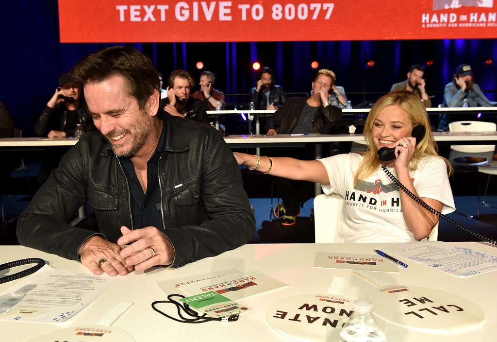 . NASHVILLE, TN - SEPTEMBER 12:  In this handout photo provided by Hand in Hand, Charles Esten and Reese Witherspoon attend Hand in Hand: A Benefit for Hurricane Relief at the Grand Ole Opry House on September 12, 2017 in Nashville, Tennessee.  (Photo by John Shearer/Hand in Hand/Getty Images)