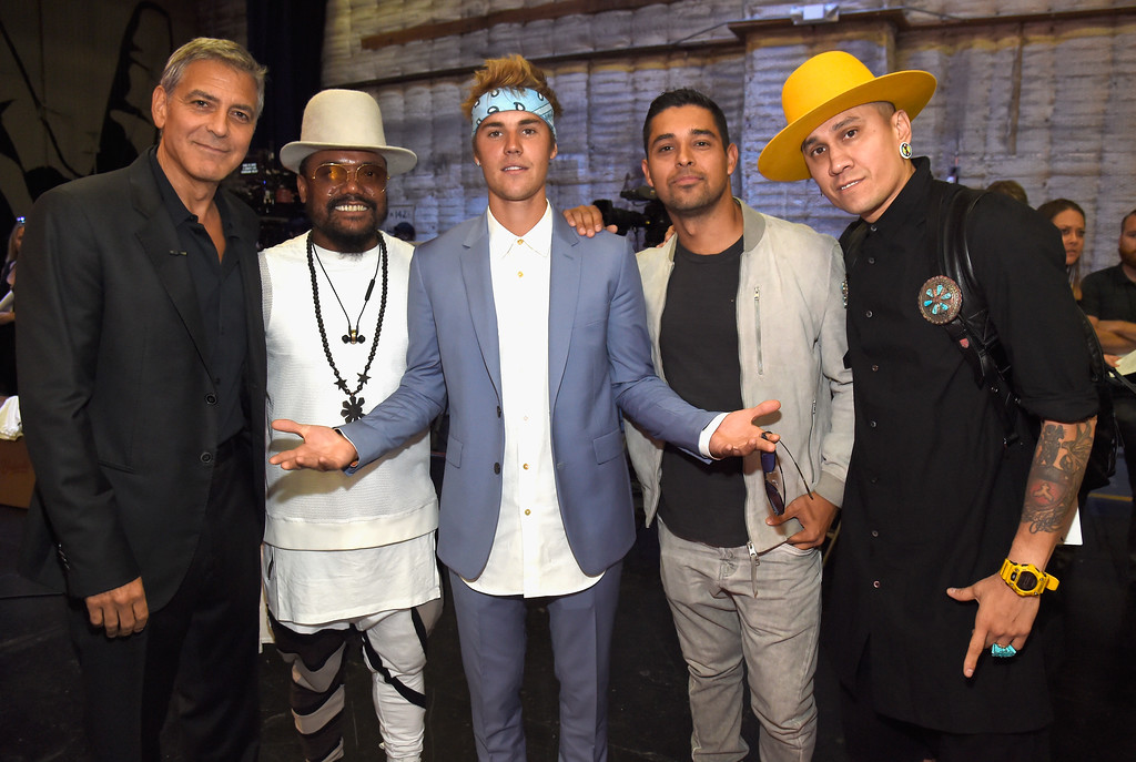 . UNIVERSAL CITY, CA - SEPTEMBER 12:  In this handout photo provided by Hand in Hand, George Clooney, will.i.am, Justin Bieber, Wilmer Valderrama and Taboo attend Hand in Hand: A Benefit for Hurricane Relief at Universal Studios AMC on September 12, 2017 in Universal City, California.  (Photo by Kevin Mazur/Hand in Hand/Getty Images)