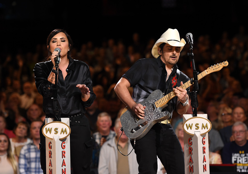 . NASHVILLE, TN - SEPTEMBER 12:  In this handout photo provided by Hand in Hand, Demi Lovato and Brad Paisley perform onstage during Hand in Hand: A Benefit for Hurricane Relief at the Grand Ole Opry House on September 12, 2017 in Nashville, Tennessee.  (Photo by John Shearer/Hand in Hand/Getty Images)