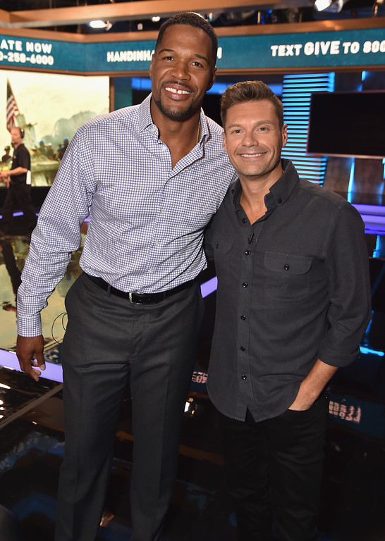 . NEW YORK, NY - SEPTEMBER 12:  In this handout photo provided by Hand in Hand, Michael Strahan and Ryan Seacrest caption at ABC News\' Good Morning America Times Square Studio on September 12, 2017 in New York City.  (Photo by Theo Wargo/Hand in Hand/Getty Images)