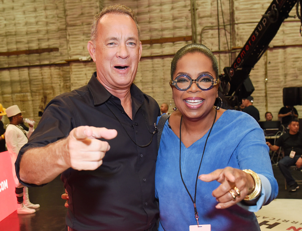 . UNIVERSAL CITY, CA - SEPTEMBER 12:  In this handout photo provided by Hand in Hand, Tom Hanks and Oprah Winfrey attend Hand in Hand: A Benefit for Hurricane Relief at Universal Studios AMC on September 12, 2017 in Universal City, California.  (Photo by Kevin Mazur/Hand in Hand/Getty Images)