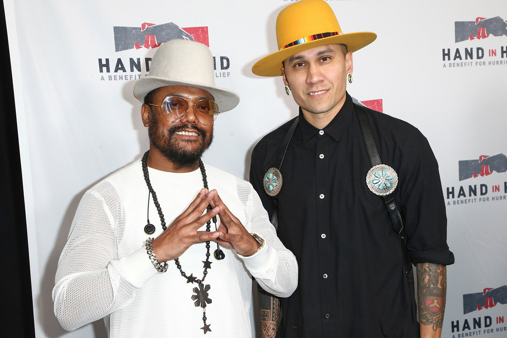 . Allan Pineda Lindo, known as apl.de.ap, left, and Taboo attend the Hand in Hand: A Benefit for Hurricane Harvey Relief held at Universal Studios Back Lot on Tuesday, Sept. 12, 2017 in Universal City, Calif. (Photo by John Salangsang/Invision/AP)