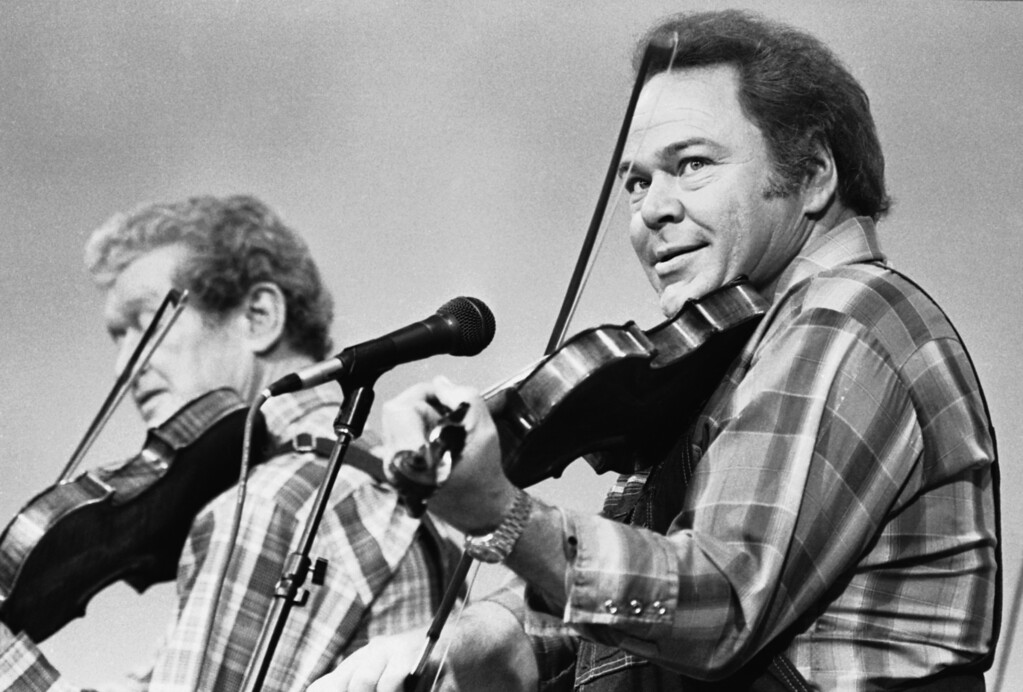 ". Entertainer Roy Clark (right) plays the fiddle during a taping of the syndicated television show ""Hee Haw,\"" June 27, 1983. Also playing is Roy Acuff, \""the King of Country Music.\"" (AP Photo/Mark Humphrey)"
