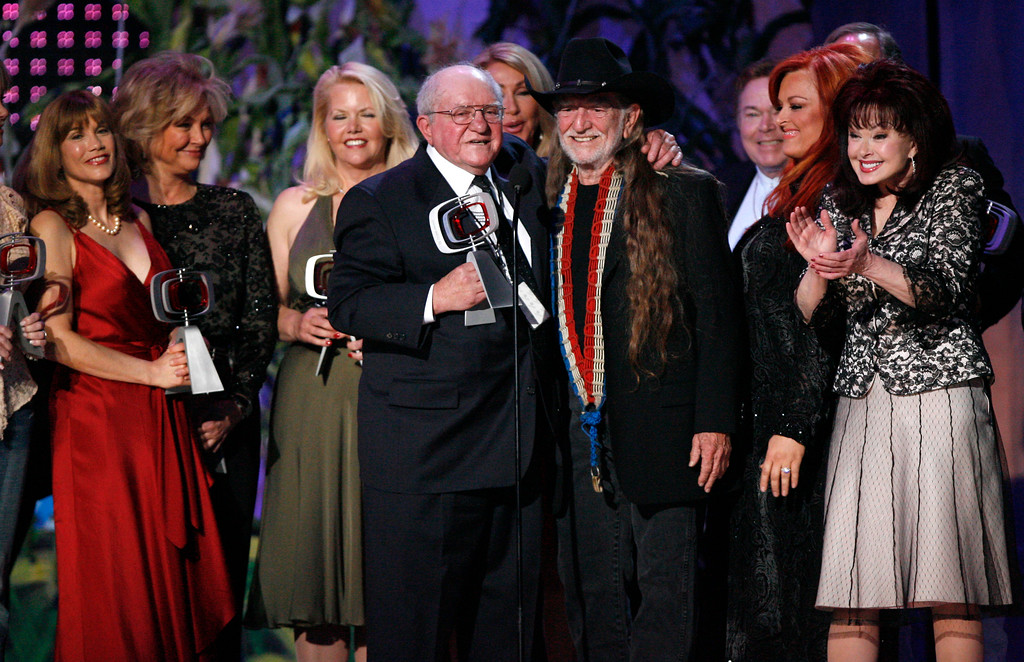 ". FILE - In this April 14, 2007, file photo, producer Sam Lovullo, center left and singer Willie Nelson, right along with the cast of the television show ""Hee Haw\"" accept the Entertainer\'s Award during the 5th Annual TV Land Awards in Santa Monica, Calif. Publicists the Brokaw Company said Thursday, Jan. 5, 2017, that Lovullo died at his home in Los Angeles on Tuesday, Jan 3, 2017. He had been suffering from heart disease. He was 88. (AP Photo/Gus Ruelas, File)"