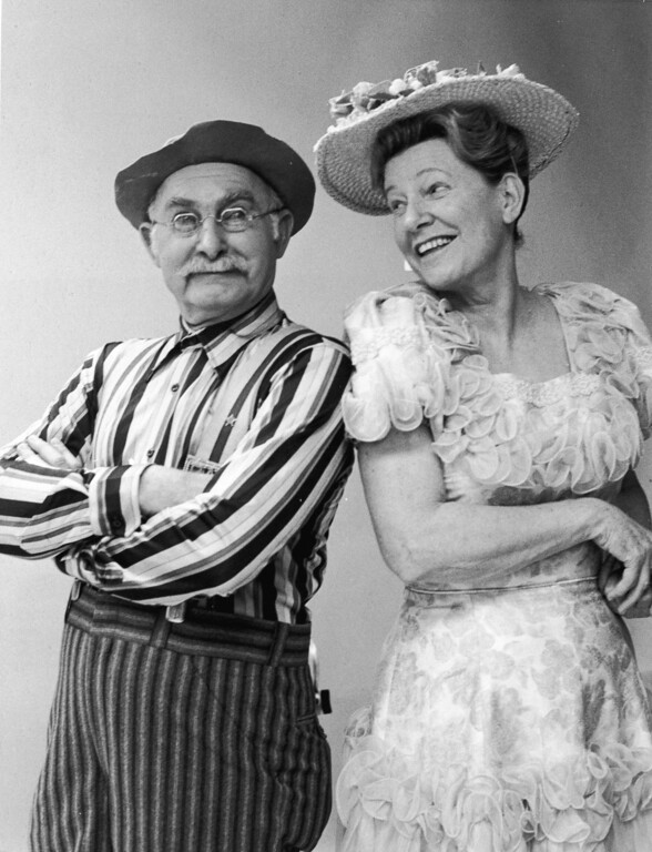 . American actors Grandpa Jones (1913 - 1998) and Minnie Pearl (1912 - 1996) in a promotional portrait for the television program, \'Hee Haw,\' circa 1978. (Photo by NBC Television/Courtesy of Getty Images)